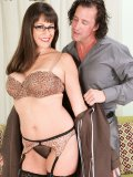 Kinky Tori rocks the sexy wife look with her glasses and garter belt combo