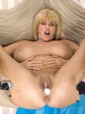 MILF with enormous natural jugs spreads her pussy lips to show her large clit
