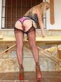 Naughty mommy in sheer stockings acting out a prostitute locked away in prison