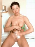 Hot mama shows her boobs and sexy bumps in the shower room. See how she grabs her tits?