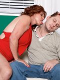 Horny young guy bites on mature redhead's clit piercing tenderly making her moan