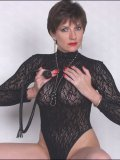 Menacing mature dominatrix bares her body but holds on to her scorching whip