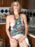 Slim mature hottie soaps her whole sexy body up and showers it in kitchen sink