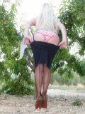 Mom poses in stockings on sexy garter belt but with no panties on  all alfresco