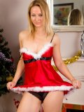 Blonde slut dresses up in sexy Christmas costume. See her large boobs as she strips off!