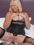 Old bustys black see-through lingerie looks awesome together with her stockings