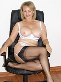 Blonde housewife goes wild fucking herself with a huge dildo in an office chair
