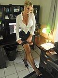 Babe strips down in the office to give her boss a taste of her perfect body