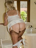 Naughty blonde Sandy loves playing with her juicy pussy wearing hot stockings