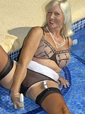 Naughty blonde housewife loves to fuck herself with a huge dildo by the pool
