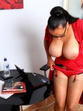 Boobalicious mature Latina gets hot at work and takes a little pause to jill off