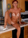 Sound interesting? This sexy chick washes her wet pussy on the sink of her kitchen!