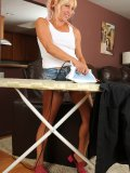 Pretty girl irons clothes till she feels really hot. Yes, it's time to strip naked!