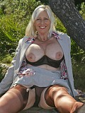 Amazing pictures of a mature Sandy playing with her massive boobs