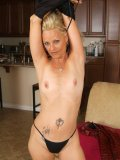 Sexy mom with several tats on her gorgeous body shows she is the ultimate whore
