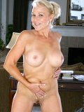 Blond older lady shows off her new fake tits and spreads buns to show her holes