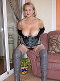 Michelle gets naughty posing in hot knee high boots and a corset