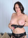 Sexy bitch in the lace bra teases her pussy with her fingers till she moans in joy!