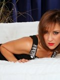 Seductive brunette Roni teases by flaunting her hot body in black stockings