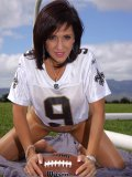 Amazing pictures of a sexy mature milf posing on a football field in her nylons