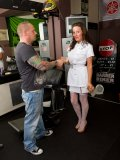 Mature hair stylist in super-sexy uniform gives watchers a nice teasing at work