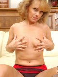 This mature vixen just can't keep her hands off her oversensitive shaven snatch