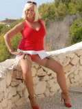 Shameless blond oldie with big natural jugs spreads her nylon-clad legs alfresco