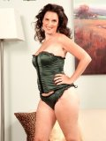 Sexy bitch unzips her green corset and exposes her tantalizing body with horny smile!