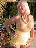 Incredibly hot pictures of a busty mature blonde revealing her hot pussy in stockings