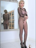 Stacked mature blondie posing in an outfit that reveals much more than in hides