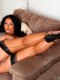 Latin ma with very big breasts slides out of panties and spreads stockinged legs