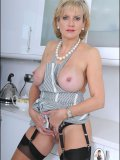 Our MILF cook wears nothing but an apron and stockings for her sizzling hot show