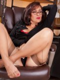 Ripe businesswoman in glasses lets you see her damn sexy stockings and underwear