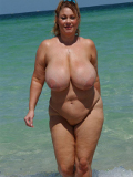 Its summer! Hot chick strips in the sea and enjoys her nude swimming with total joy!