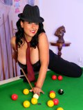 This dangerous stacked MILF knows how to handle big sticks and balls on table