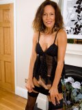 Skinny wife looks absolutely mind-blowing in black lingerie and on high heels