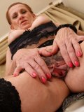 Granny in sexy black stockings invites you to scrutinize her yummy unshaven twat
