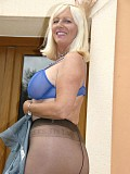 Insanely hot pictures of a blonde housewife twisting her nipples while posing in stockings