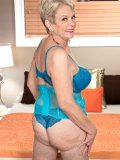 Fat hoochie mama in a tight blue corset gets her mature snatch stuffed