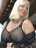 Stunning pictures of a mature blonde flaunting her killer ass in sexy black stockings