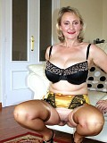 Ravishing busty mature milf shows off her amazing body in a sexy dress and stockings