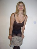 Hot blonde milf teases by posing in her sexy nylons and hiding her juicy cunt