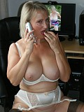 Naughty mature milf having phone sex while stroking her clit in hot white lingerie