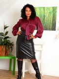 Latin mama shows the yummy hairy pussy hiding underneath her sheer black tights