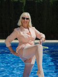 Busty mom in cool-ass vintage outfit hops into the pool to get her stockings wet