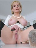 Older blondie with very heavy rack takes a sip of wine and plays with her snatch