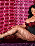 Ravishing brunette housewife plays with her giant boobs while posing in fishnets