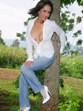 Beautiful mature milf posing in her sexy white stockings in her garden