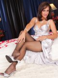 Slutty mature housewife playing with herself on the bed in nylons