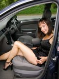 MILF Cindy gets so horny while driving in her car and ends up masturbating there